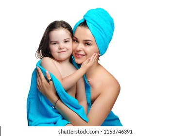 Happy family after bath wearing blue towels