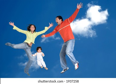 happy family in the air over a beautiful blue sky - focus is on the child