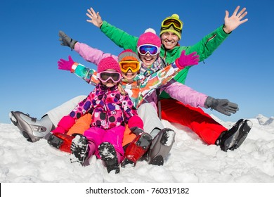 happy family in alpin ski equipment at the ski resort