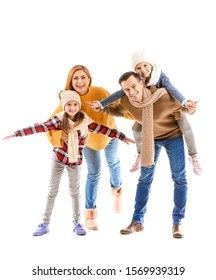 Happy family in autumn clothes on white background