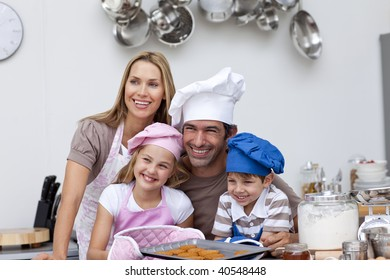Happy family baking cookies in the kitchen