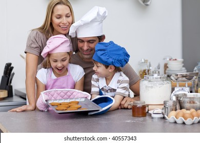 Happy family baking cookies together in the kitchen