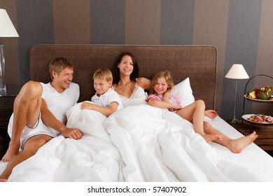 happy family in bed - good morning