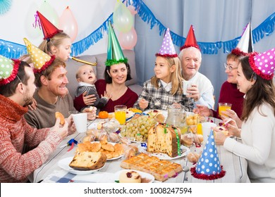 Happy family behaving jokingly during childrenâ??s birthday party