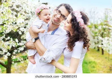 Happy family in a blossom garden