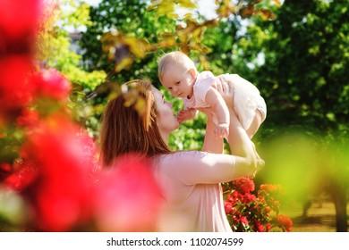 happy family in  the blossom roses garden