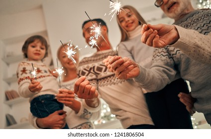 The happy family with bright sparklers