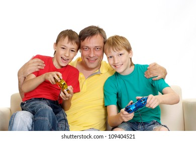 Happy family in bright T-shirts have fun in the company of each other