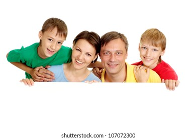 Happy family in bright T-shirts on a white background