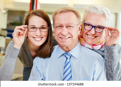 Happy family buying new glasses at optician retail store