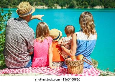 happy family by the sea on nature picnic