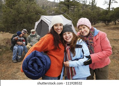 Happy family camping together