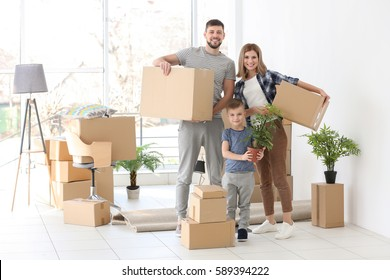 Happy family with cardboard boxes. Moving concept