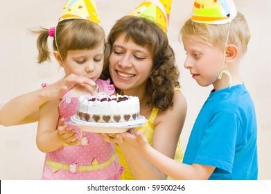 Happy Family celebrates birthday with a cake