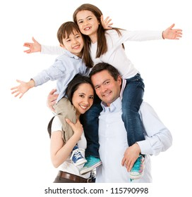 Happy family celebrating with arms up - isolated over white