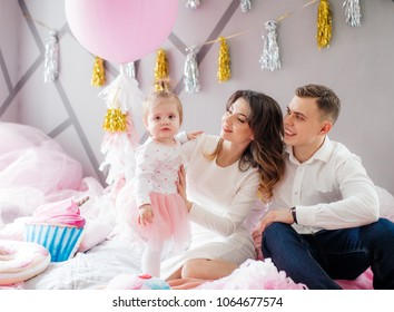 Happy family celebrating birthday of little girl