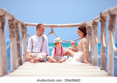 happy family celebrating wedding together on tropical island
