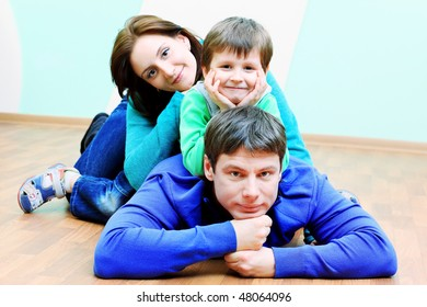 Happy family with a child at home.