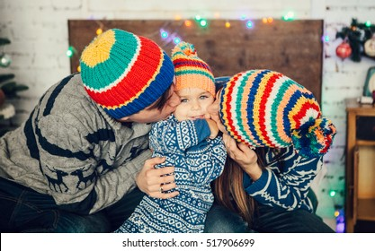 5df2bc02467 Happy family with child in the New Year decorations. Christmas concept