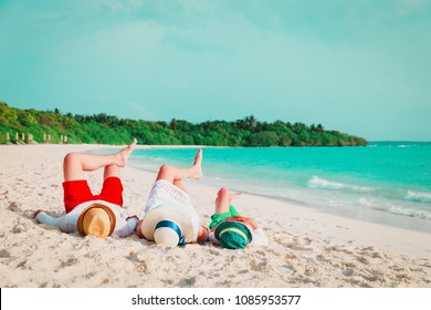 happy family with child relax having fun on beach