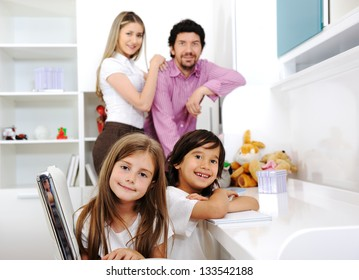 Happy family with children at home