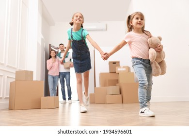 Happy family with children moving into new house, low angle view