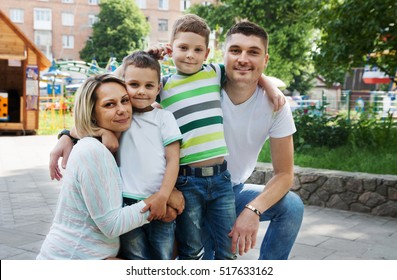 happy family with children on the walk in the park