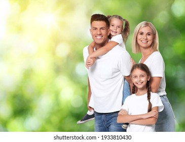 Happy family with children outdoors on sunny day, space for text