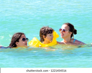 happy family with children in the sea. Sea entertainment concept