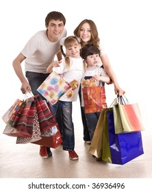 Happy family and children shopping. Isolated.