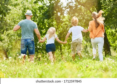 Happy family and children in the summer in nature