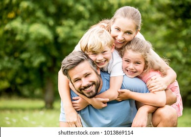 Happy family with chlildren together embracing each other