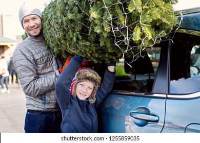 happy family christmas tree shopping, taking the tree off car roof, enjoying magical time together
