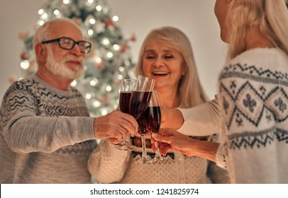 The happy family clink glasses of wine