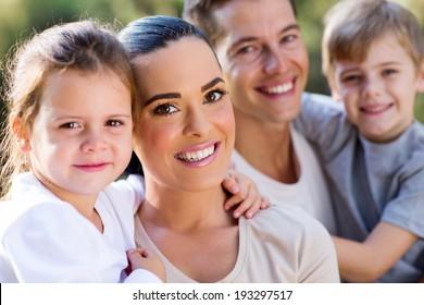 happy family closeup portrait outdoors