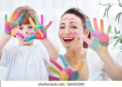 Happy family with colorful hands