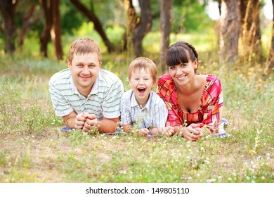Happy family concept. Father, mother and son outdoors.
