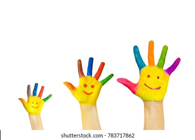 Happy family concept. Three hands of father, mother and child. Drawn smiley faces on colorful hands. The family smiles and laughs. Family has fun together. Isolated on white background.