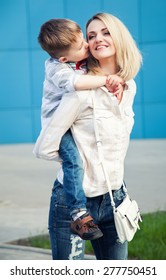 happy family concept. Young and beautiful mother and her child having fun outdoor.