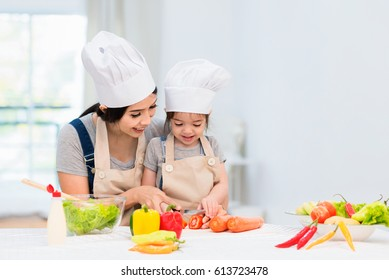 Happy family cooking biscuits together in kitchen at home for family