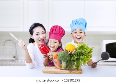 Happy family is cooking in the kitchen together