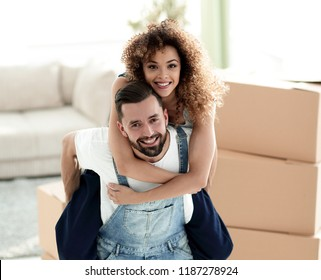 Happy family couple embracing in a new house