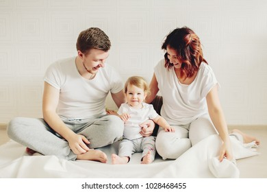 happy family and Daughter playing  at home.