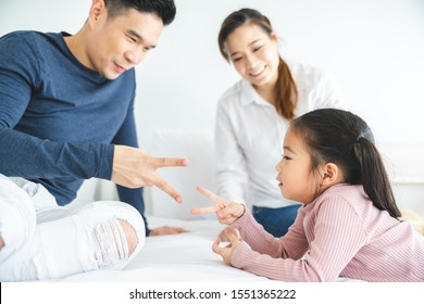 Happy family with daughters playing at home and weekend for family