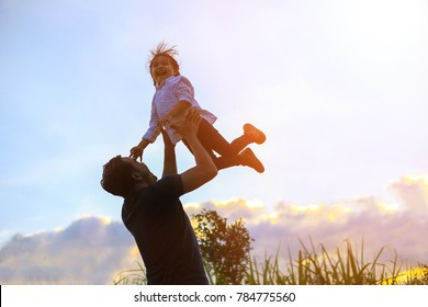 Happy family day. dorable happy child playing with father