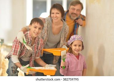happy family doing repair at home