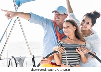 Happy family doing sail boat trip - Father, mother and daughter having fun traveling in caribbean sea - Travel, love and alternative vacation concept - Main focus on kid face