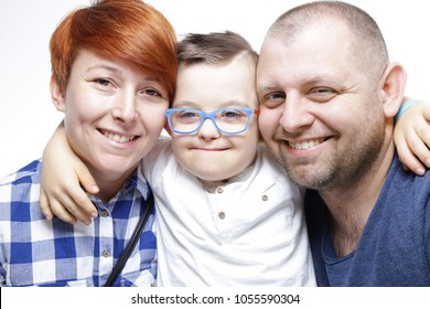 Happy family with down syndrome child