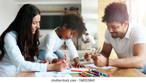 Happy family drawing and spending time together