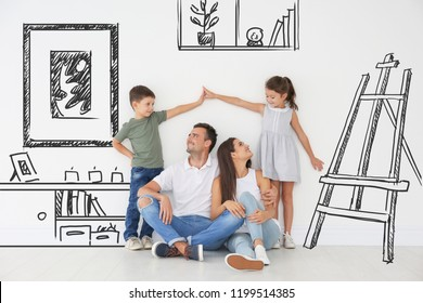 Happy family dreaming about moving into new house on white wall background